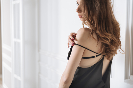 Tender woman touching her shoulder Stock Photo