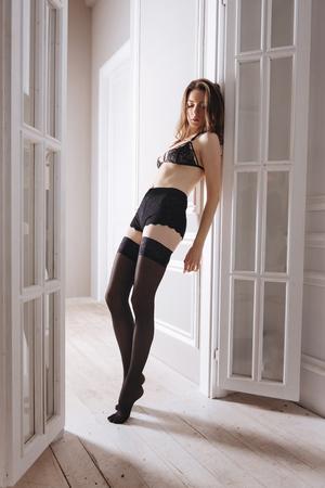 Sensual girl posing between doors