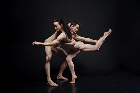 Proficient dancers performing together in the studio Stock Photo