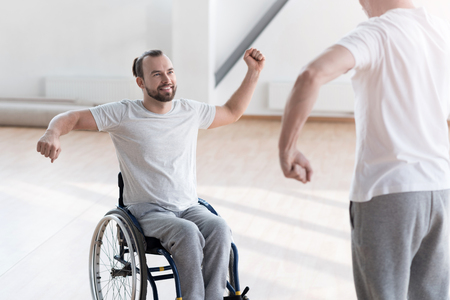Charming young disabled patient training in the gym Stock Photo