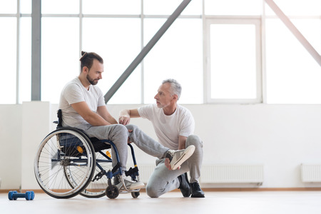 orthopedist: Serious physical therapist providing a healthcare class to the patient Stock Photo