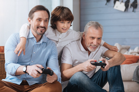 Delighted happy men playing video games