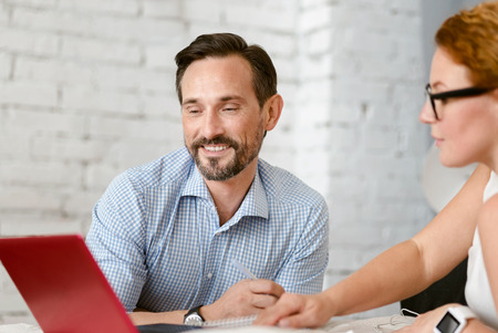 Educated middle aged couple communicating at home Stock Photo