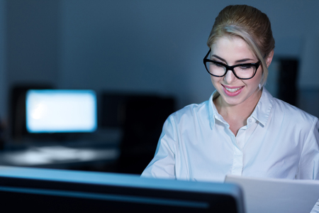 Skillful young businesswoman working in the office Stock Photo