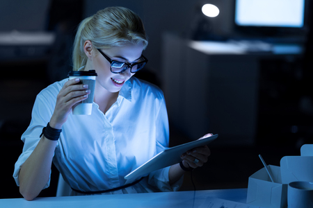 Young female programmer using modern device in the office