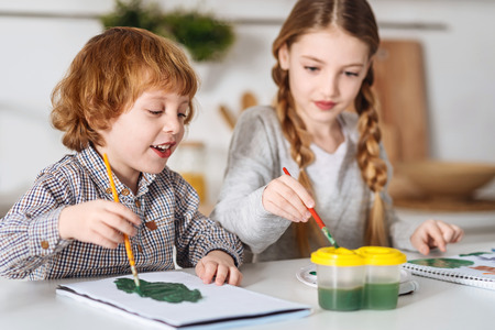 Artistic children enjoying their hobby during the weekend