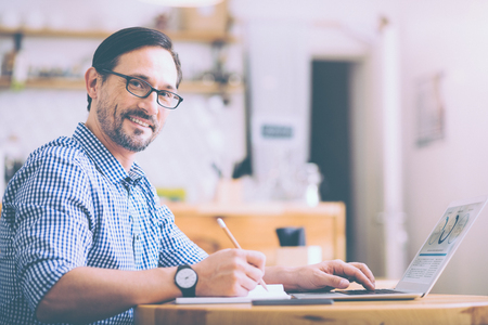 businesslike: Positive adult man sitting in the cafe Stock Photo