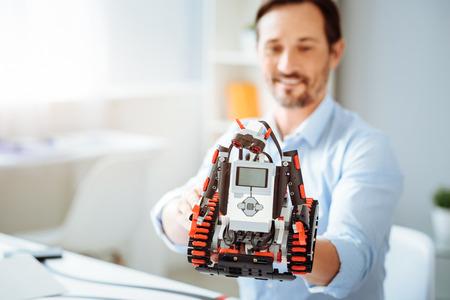 Professional engineer holding robot