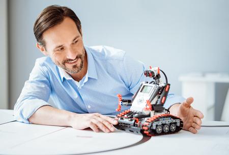 Positive man using robot