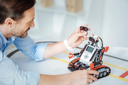 Pleasant engineer testing the robot Stock Photo