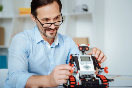 Positive engineer inspecting functions of robot