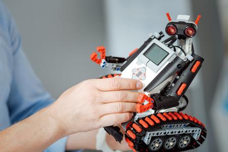 Pleasant engineer testing modern robot Stock Photo