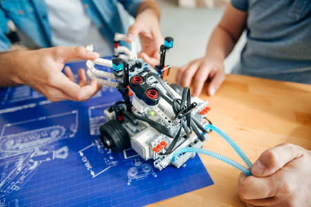 Professional engineers constructing the robot