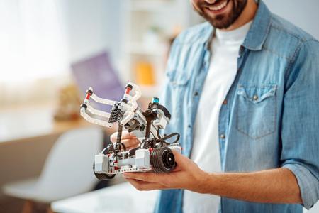 Smiling engineer demontrating robot Stock Photo
