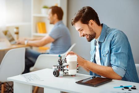 Positive engineer testing the robot