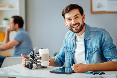 Positive professional engineer testing robot