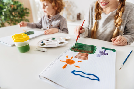 Talented bright kids sketching nature Stock Photo