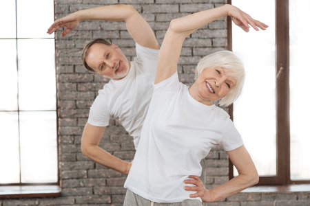 gerontology: Attractive old woman doing morning exercises Stock Photo