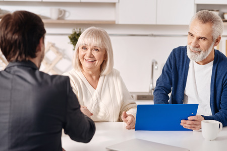 Successful lawyer working with aged couple in the house Stock Photo
