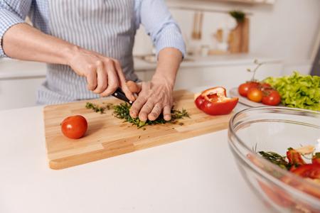 abilities: Capable man preparing vegetarian dish in the kitchen Stock Photo