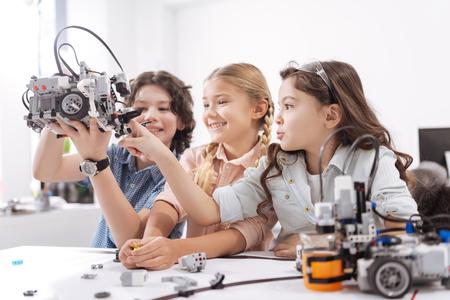 Joyful kids testing modern device at school Stock Photo