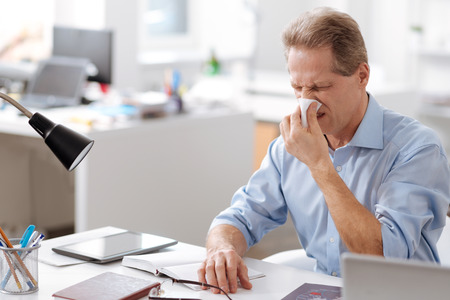 Photo of sick man having nasal problems Stock Photo