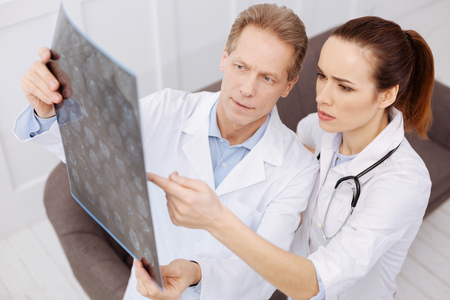 Prominent doctor and his intern discussing the diagnosis Stock Photo