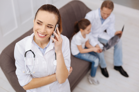concern: Charming qualified medical worker telling good news Stock Photo