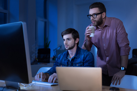 Nice attractive programmer typing Stock Photo