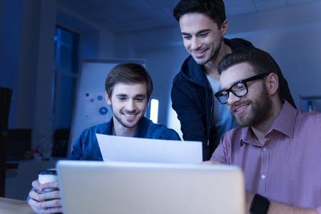 Positive joyful programmers enjoying working together
