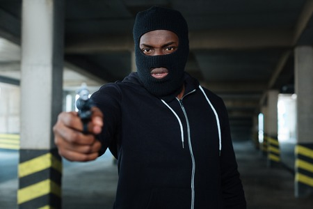 Aggressive dangerous man wearing a mask