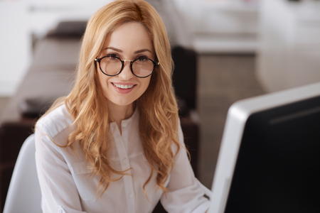 Charming young manager enjoying responsibilities at the workplace Stock Photo