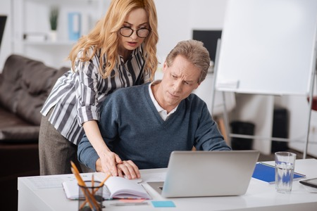 Initiative office manager working with colleague in the office Stock Photo