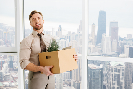 Pleasant office worker getting promotion in the company Stock Photo