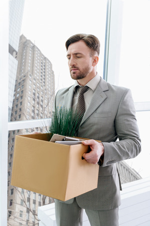 Fired man standing in the office