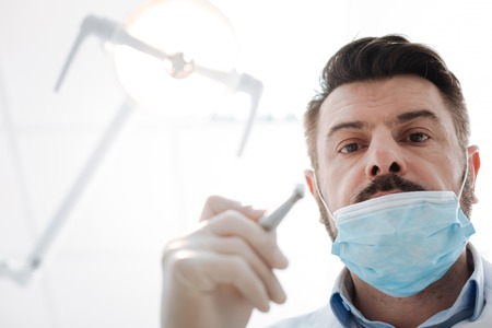 Successful committed dentist at work