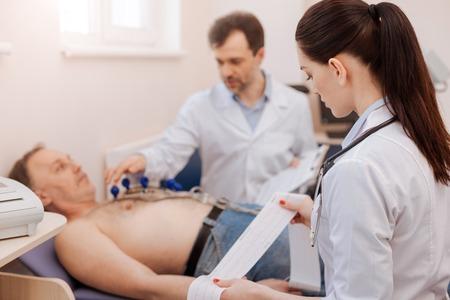 Excellent team diagnosing a heart disease