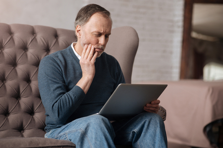 gerontology: Senior man with terrible toothache Stock Photo