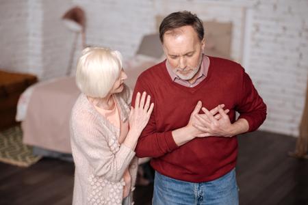 heartache: Aged man with heartache near wife Stock Photo