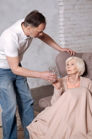 Senior man leaning to his wife