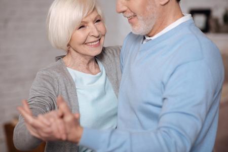 Closeup of smiling woman dancing with husband Stock Photo