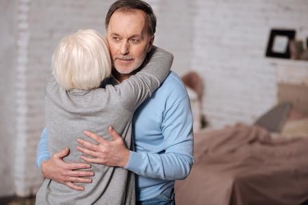 gerontology: Back view of elderly woman hugging husband