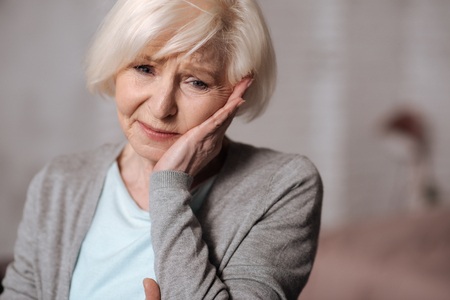 Close up of depressed aged woman Stock Photo