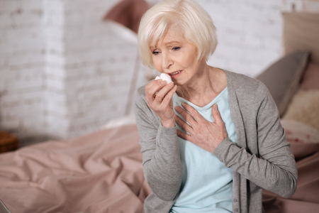 Elderly lady sick woman feeling bad Stock Photo