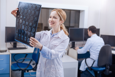 oncologist: Happy beautiful oncologist being in a wonderful mood Stock Photo