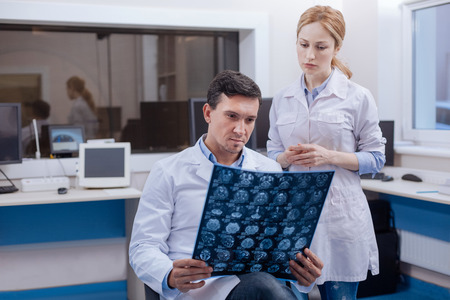 oncologist: Handsome confident oncologist thinking about the diagnosis