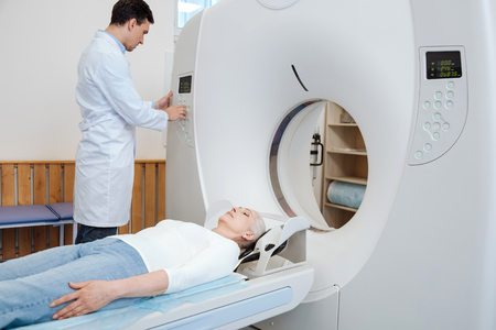 Serious male doctor using MRI scanner