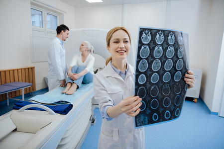 Positive happy doctor working in the CT lab