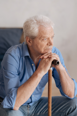 gerontology: Nice grey haired man leaning on the walking stick