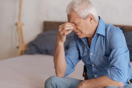 gerontology: Moody aged man feeling unhappy